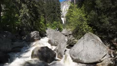 spring high water levels on vernal falls in yosemite national park, as seen from the bridge over the merced river