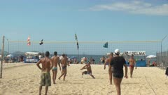 shot of a point being played in a volleyball game on copacabana beach in rio de janeiro, brazil