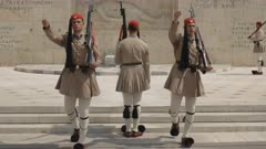 two evones guards march towards the camera during the changing of the guard ceremony at the parliament building in athens, greece