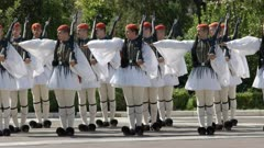 full dress uniformed evzones on parade at the greek parliament in athens, greece