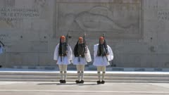 three guards walk towards the camera at the changing of the guard ceremony at the greek parliament in athens, greece