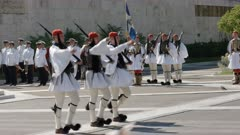 side on view of three guards marching away from the tomb of the unknown soldier at the greek parliament in athens, greece