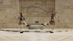 guards passing at the tomb of the unknown soldier near the greek parliament in athens, greece