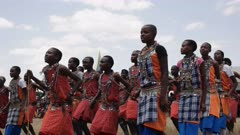 low angle view of a group of maasai boys dancing at koiyaki guiding school graduation ceremony in kenya