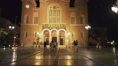 night time tilt up shot of the metropolitan cathedral of athens, greece