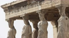 panning shot of the erechthion caryatids at the acropolis in athens, greece