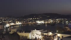 night time view of the main town of chora on mykonos, greece