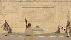 two guards march away from tomb of the unknown soldier at the greek parliament in athens, greece