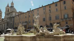 fountain of neptune with lens flare at piazza navona in rome, italy