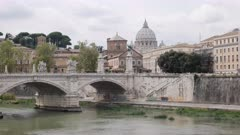 zoom in shot of st peter's basilica and the tiber river in rome, italy