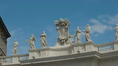 zoom in shot of statues in st peter's square at the vatican in rome