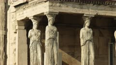 zoom in shot of the erechthion maidens in athens, greece