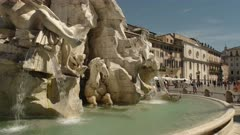 day time close up of rome's four rivers fountain in piazza navona, italy