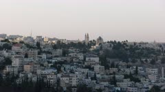 panning shot of the old city of jerusalem and the mount of olives from haas promenade in jerusalem, israel