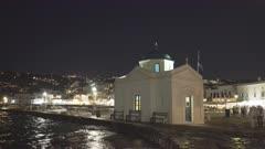 night shot of agios nikolakis church on mykonos, greece