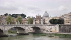the dome of st peter's basilica and tiber river from castel santangelo in rome, italy