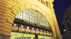 close up of the entrance to flinders street station in melbourne at night