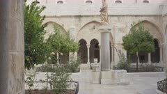 3 axis gimbal  shot walking in the courtyard of the church of the nativity in bethlehem