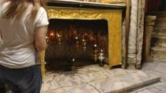 a female worshiper a worshiper kneels at the star in church of the nativity in bethlehem