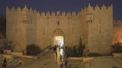 the damascus gate at dusk in the old city of jerusalem in israel