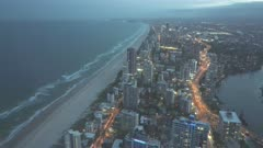 dusk zoom in shot to the south from the Q1 building at surfers paradise in queensland, australia