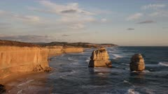 tilt down view of the twelve apostles at sunset looking east at port campbell on the great ocean road in victoria, australia