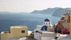 blue domed church and the caldera at the island of santorini, greece