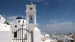 zoom in shot of the church of anastasi in Imerovigli, Santorini, Europe on the island of santorini, greece