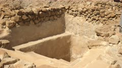 zoom in shot of a ritual bath at qumran near the dead sea, israel