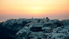 zoom in close up of oia at sunset on the island of santorini, greece