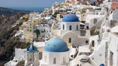 close up of the three blue domes at oia on the island of santorini, greece