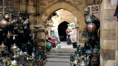 a porter carries goods at khan el khalili market in cairo, egypt