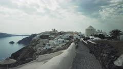three axis gimbal shot walking towards the village of oia on the island of santorini, greece