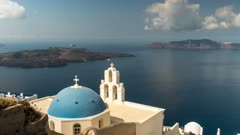 morning time lapse of the famous three bells in fira on the island of santorini, greece