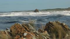 red rocks at the arthur river mouth on the west coast of tasmania, australia