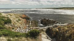 wide view of the rugged coastline and dark tannin stained water at the arthur river mouth in tasmania, australia