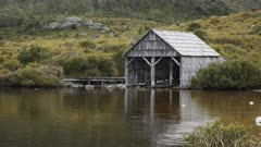 afternoon summer shot of the historic boat shed at dove lake in tasmania, australia