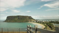 afternoon shot of the volcanic formation known as the nut and a wooden fence at stanley in tasmania, australia
