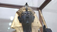 zoom in close up shot of a statue from the tomb of tutankhamun in egypt