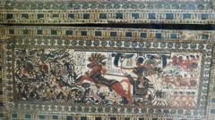 close up of the side panel of a painted chest from the tomb of tutankhamun in thebes, egypt showing him in battle