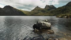 a large rock near the shore of dove lake at cradle mountain in tasmania, australia