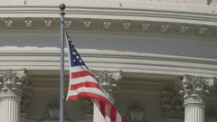 extreme close up of the flag of the united states on the us capitol building in washington d.c.
