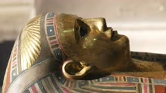 panning shot of the gilded coffin of queen tuya in cairo, egypt