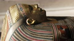 close up zoom in clip of a gilded sarcophagus in cairo, egypt