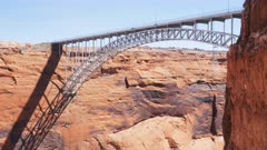close up of the steel arch bridge at glen canyon dam in page, arizona