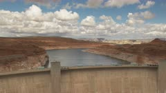 a zoom in shot of the top of the dam wall of glen canyon dam and lake powell at page in arizona, usa