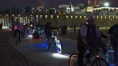 night clip of bicycles with led lights on them parading at santa monica beach near los angeles in california, usa