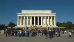 morning shot of tourists on the steps in front of the lincoln memorial in washington d.c.