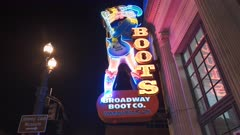 close up of a colorful neon boot sign on broadway in nashville, tn