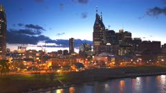 night time panning shot of downtown nashville in tennesse, usa
